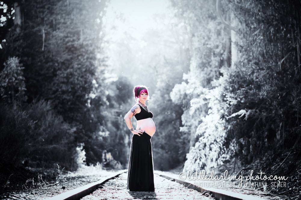 Pregnant woman on a train track