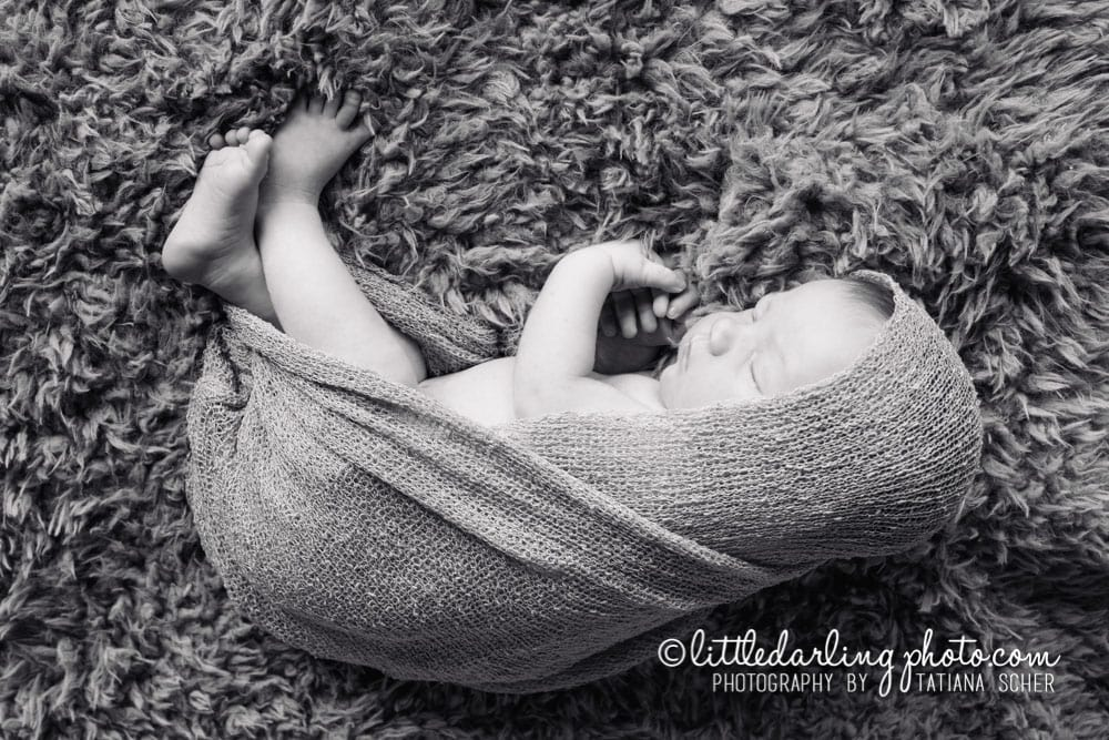 Photo of a newborn baby girl in B&W