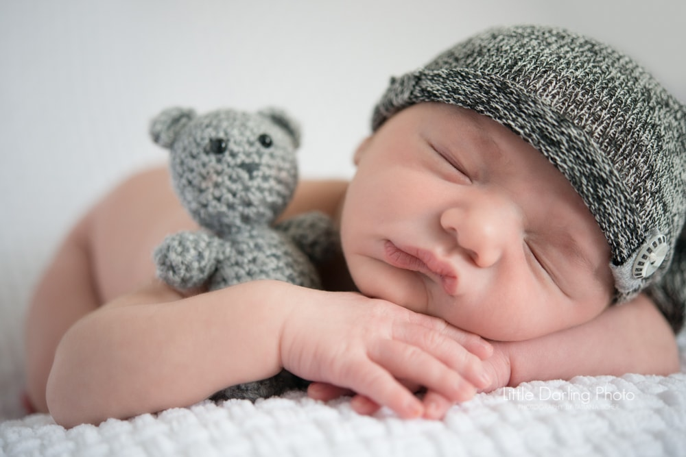 Newborn with cuddly bear